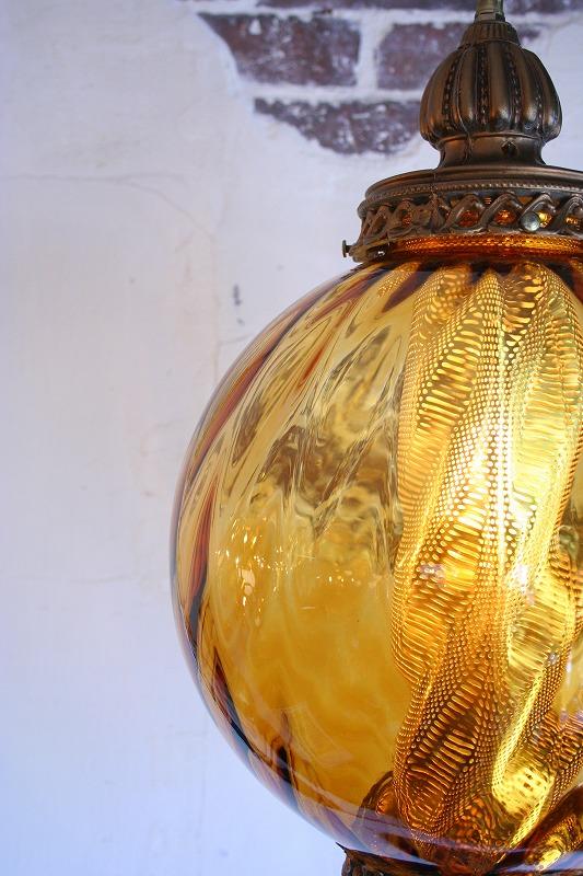Amber glass pendant light.