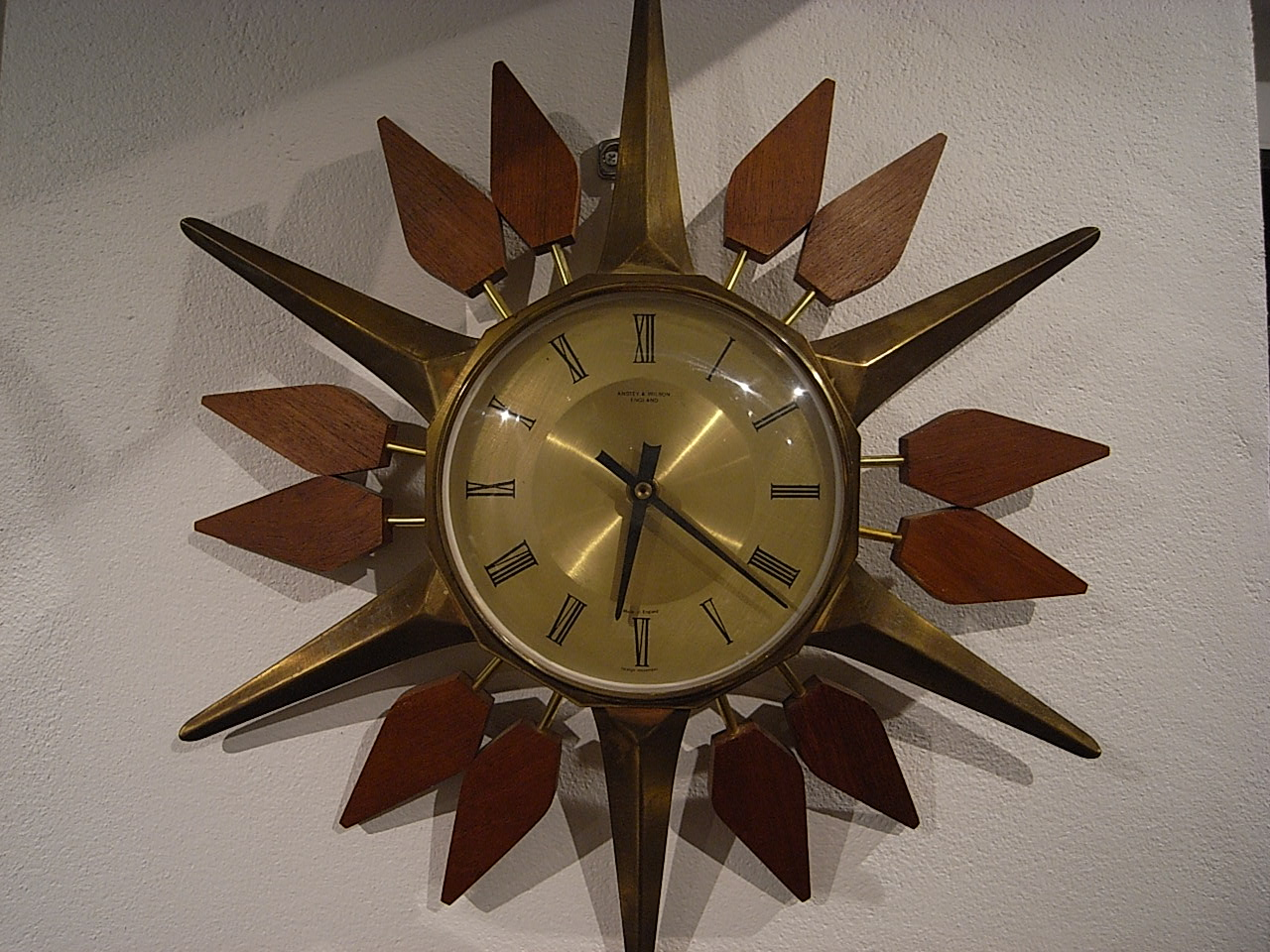 sun with spikes wall clock